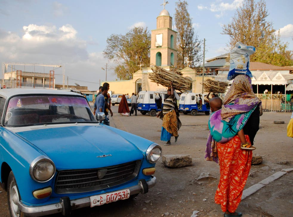 People pass across city square in Harar, Ethiopia