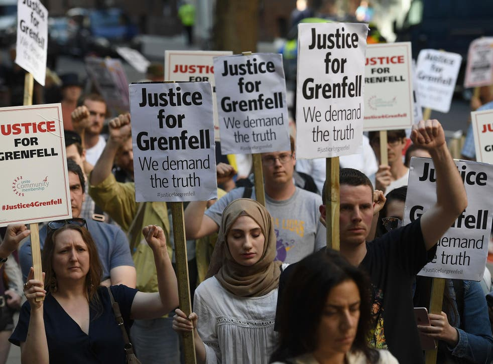 Protesters attend a rally calling for justice for those affected by the Grenfell Tower fire