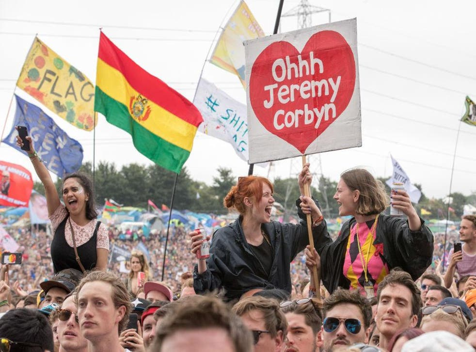 Fans cheer for Jeremy Corbyn as he speaks on the Pyramid Stage at Glastonbury
