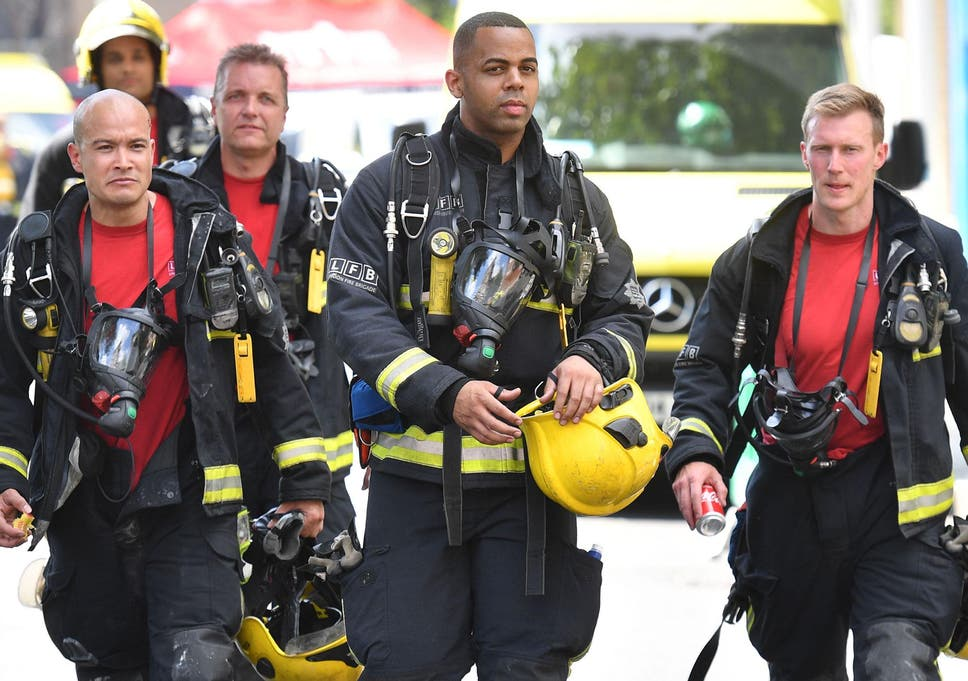Firefighters Work At The Scene Where A Fire Ripped Through Grenfell Tower On June