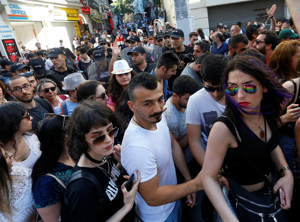 Riot police disperse LGBT rights activists as they try to gather for a pride parade, which was banned by the governorship, in central Istanbul, Turkey
