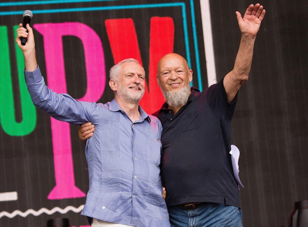 Jeremy Corbyn and Michael Eavis speak on the Pyramid Stage at Glastonbury Festival 2017 at Worthy Farm, Pilton, Glastonbury