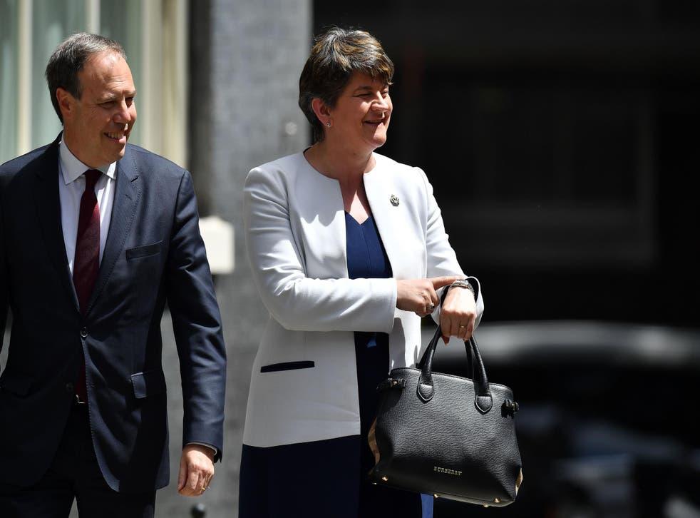 Arlene Foster arrives at Downing Street with the DUP's Westminster leader Nigel Dodds