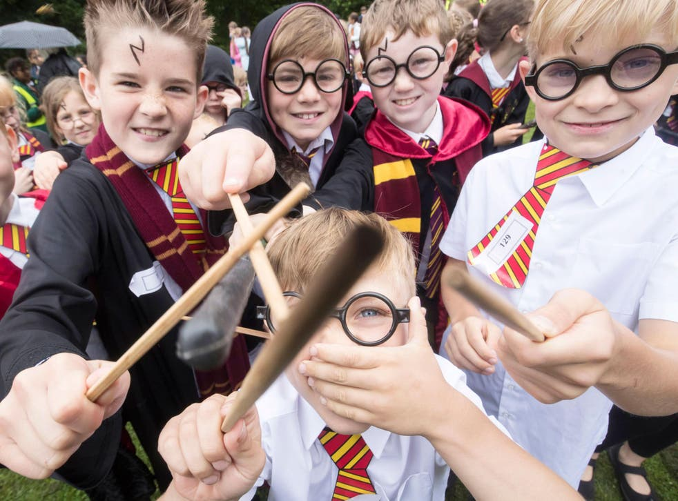 Children dressed as Harry Potter at Smithills Hall in Bolton, before they broke Guinness World Record for the Largest Gathering of People Dressed as the boy wizard