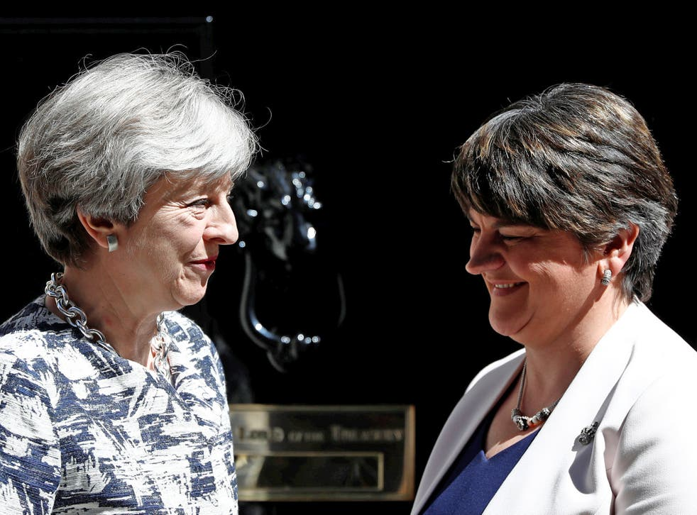 All smiles: Theresa May with DUP leader Arlene Foster outside Number 10