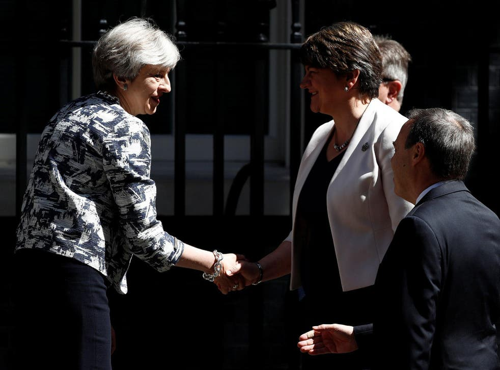 Theresa May greets Arlene Foster, the DUP leader, after they agreed the 'cash-for-votes' deal