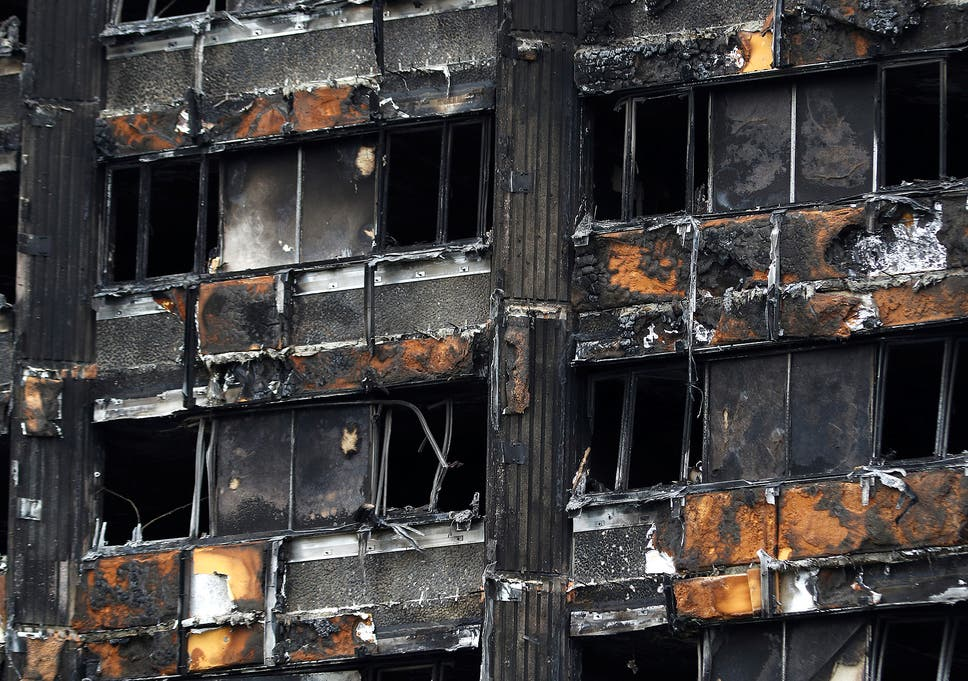 A damaged facade of Grenfell tower following the catastrophe in north  Kensington a19c2c95ae6
