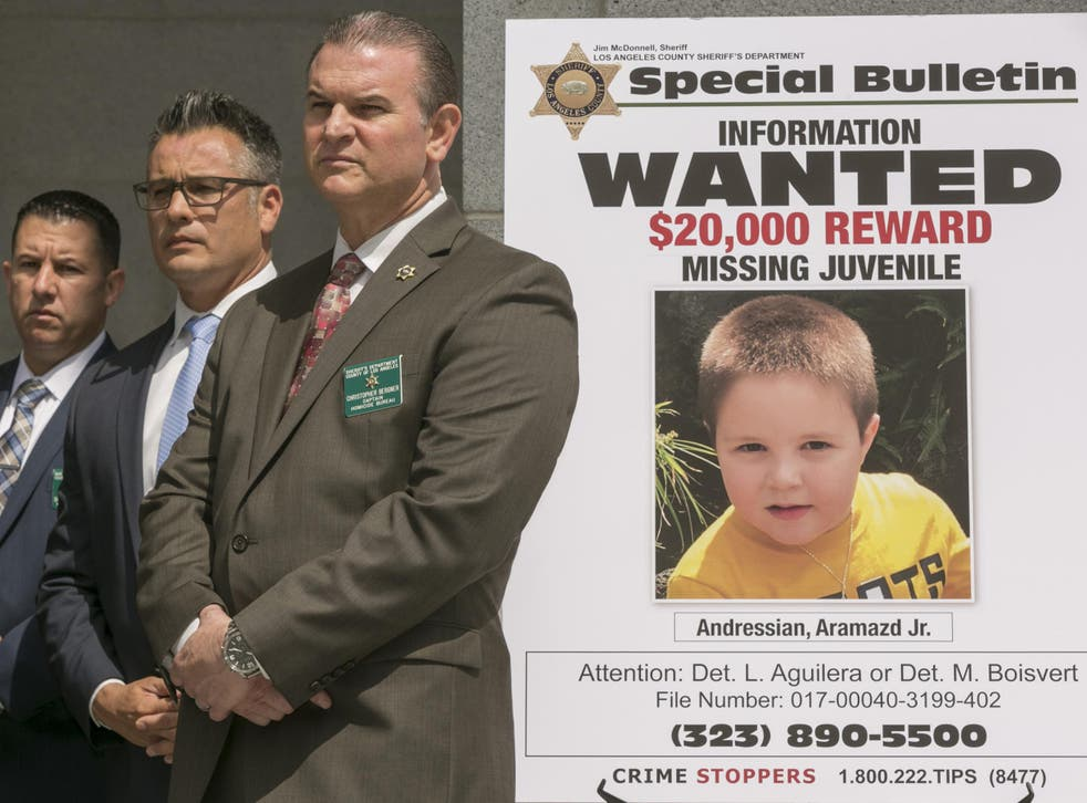 Los Angeles County Sheriff's Department Homicide Bureau Captain Christopher Bergner, centre, stands by a poster of Aramazd Andressian Jr, a five-year-old boy who has been missing for several weeks from South Pasadena
