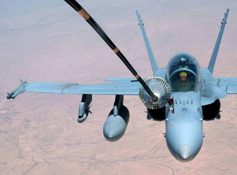 A US Marine Corps F-18 Super Hornet receives fuel from a 908th Expeditionary Air Refueling Squadron KC-10 Extender on 31 May 2017, over an undisclosed location above Syrian or Iraqi airspace
