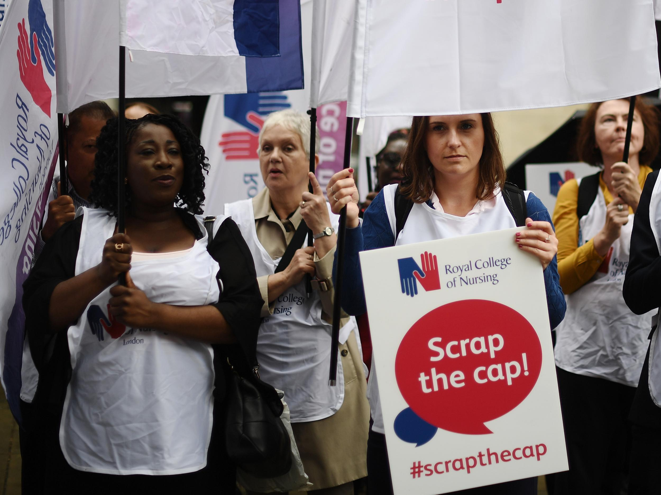 NHS nurses protest outside Health Department over low pay amp