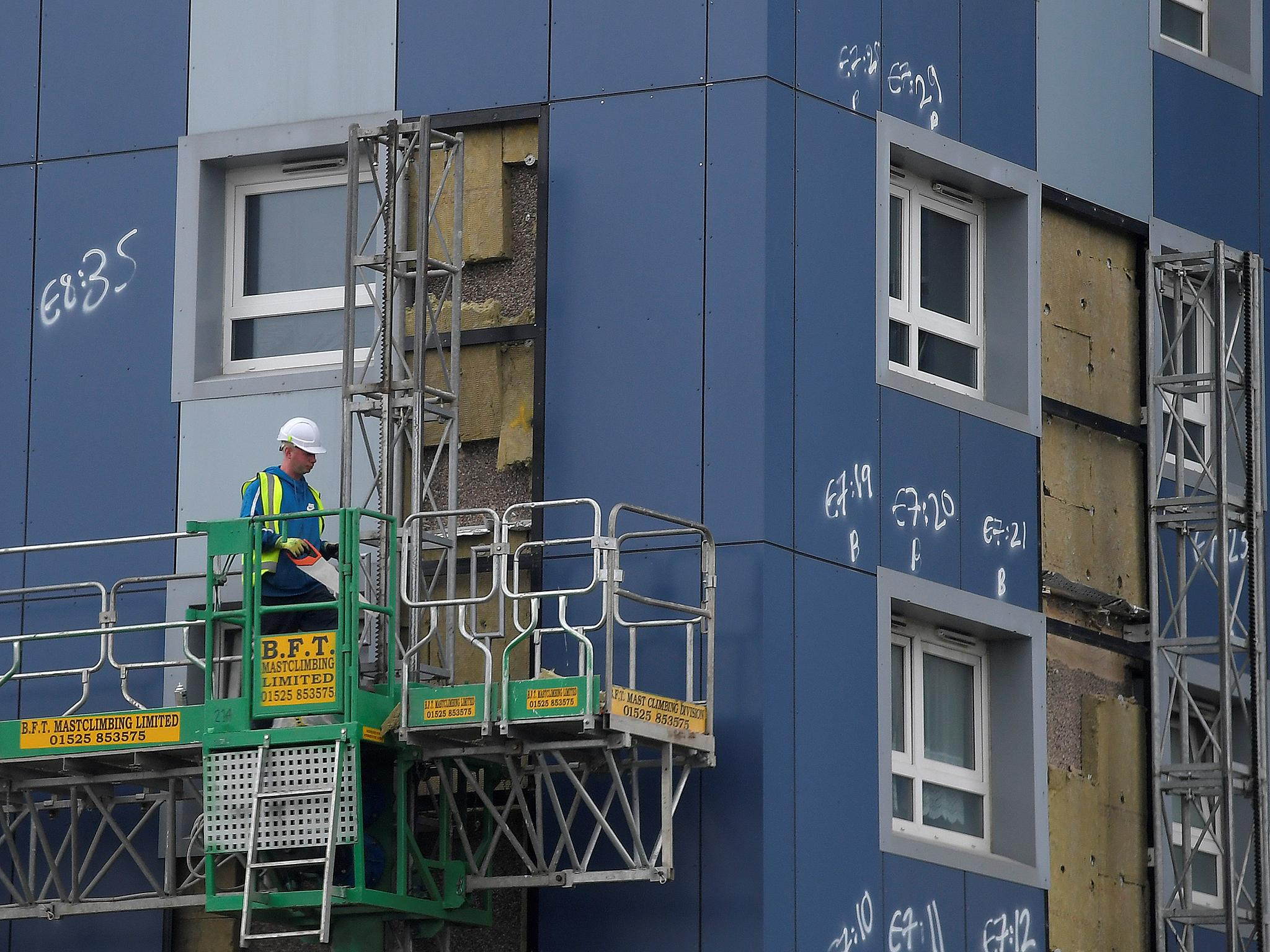 grenfell tower fire combustible cladding found on 120 blocks