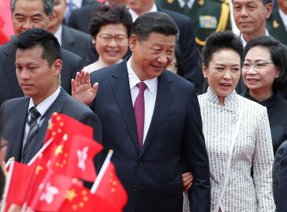 Chinese President Xi Jinping and his wife Peng Liyuan arrive in Hong Kong
