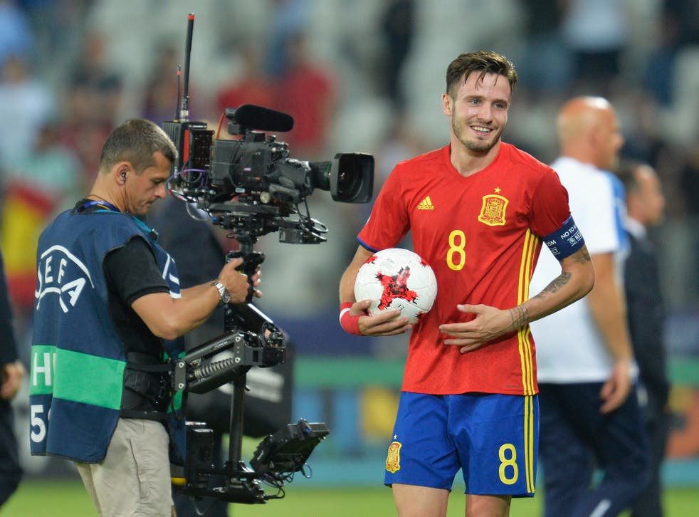 Saul Niguez claims the match ball after his semi-final hat-trick against Italy