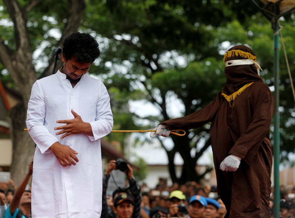 An Indonesian man is publicly caned for having gay sex