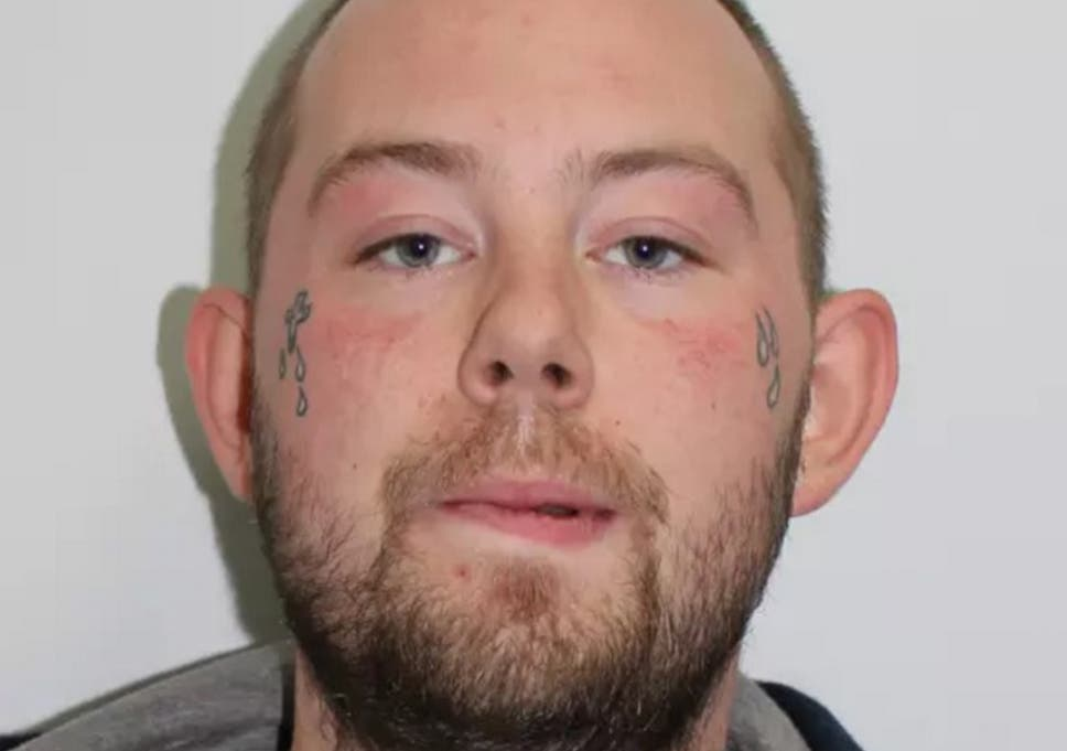 East London acid attack suspect John Tomlin smiles and blows kisses