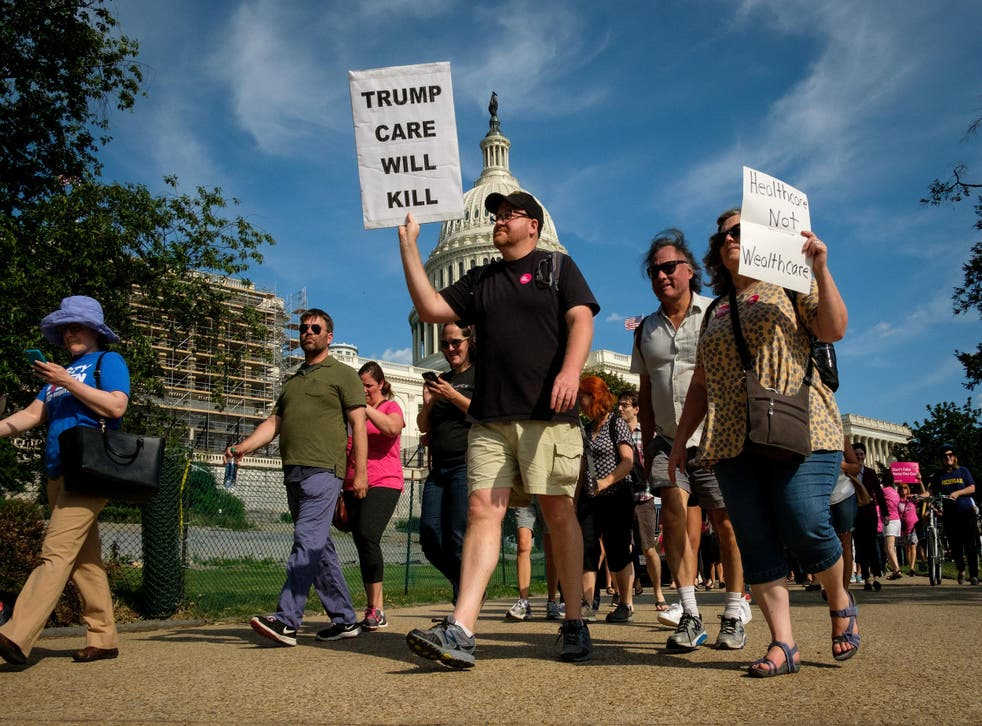 Activists march around the US Capitol to protest the Senate Republicans' health care bill