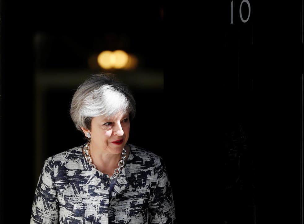 Britain's Prime Minister, Theresa May, waits to greet Democratic Unionist Party (DUP) Leader Arlene Foster, in Downing Street, in central London, Britain June 26, 2017