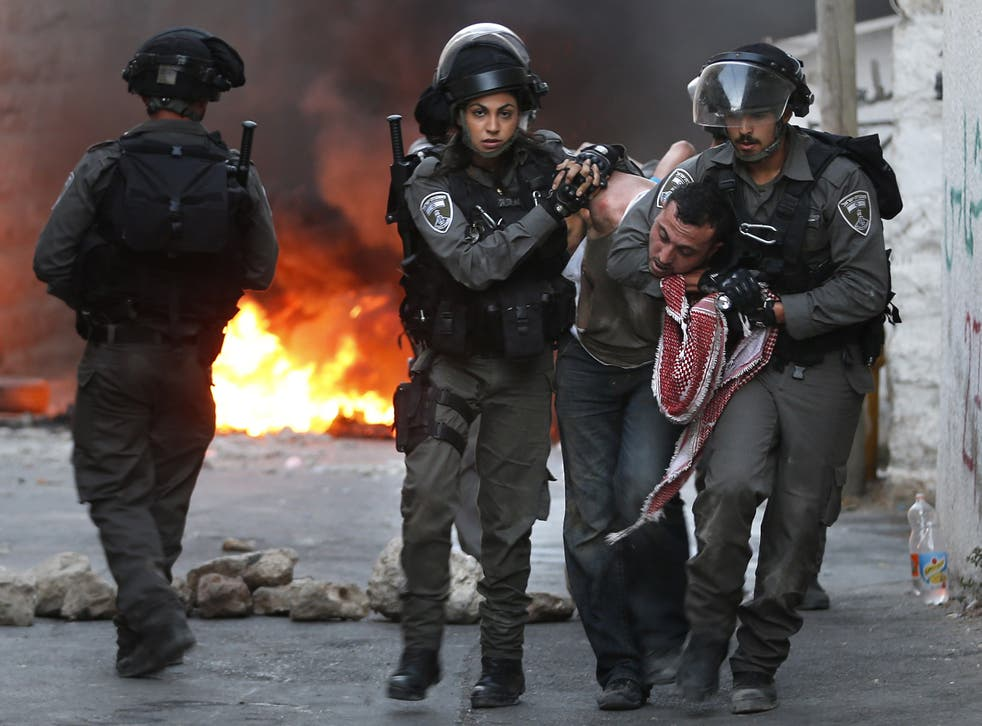 Israel police arrest Palestinian during clashes in east Jerusalem in 2015
