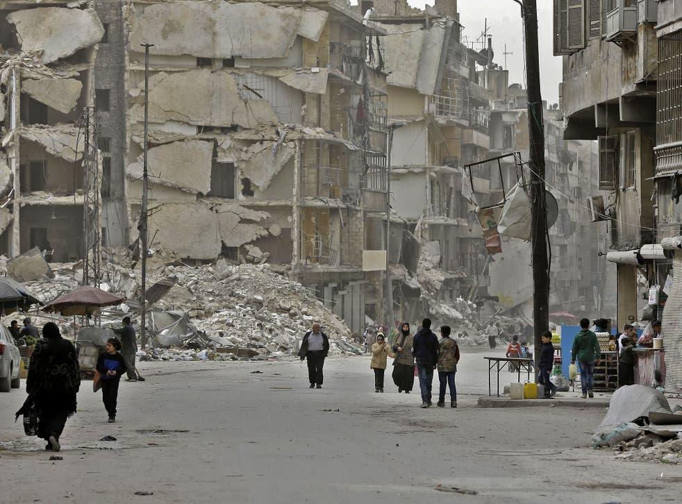 Residents in the formerly rebel-held al-Shaar district of Aleppo on 9 March 2017