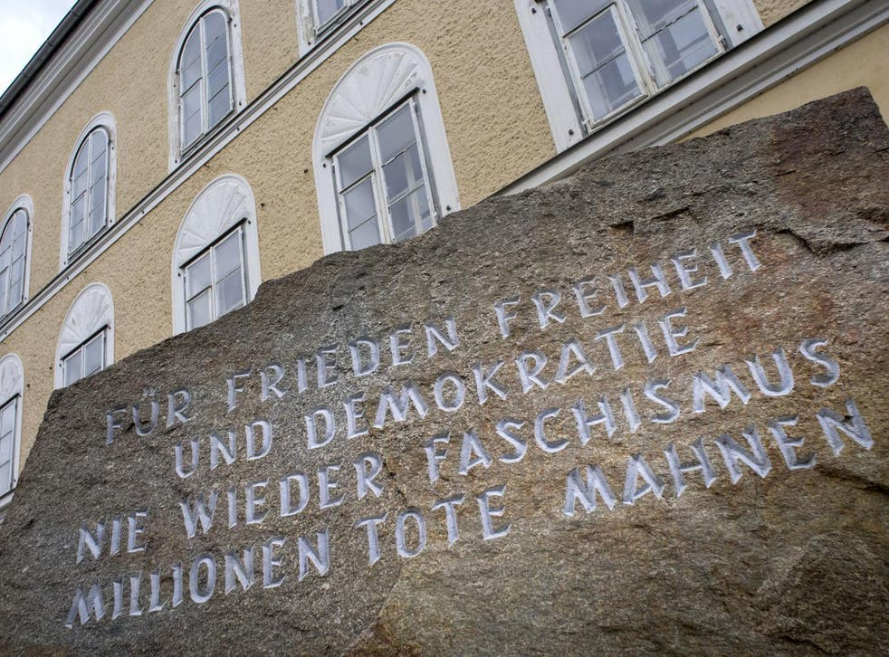 A memorial stone stands outside the house where Adolf Hitler was born in Braunau Am Inn, Austria