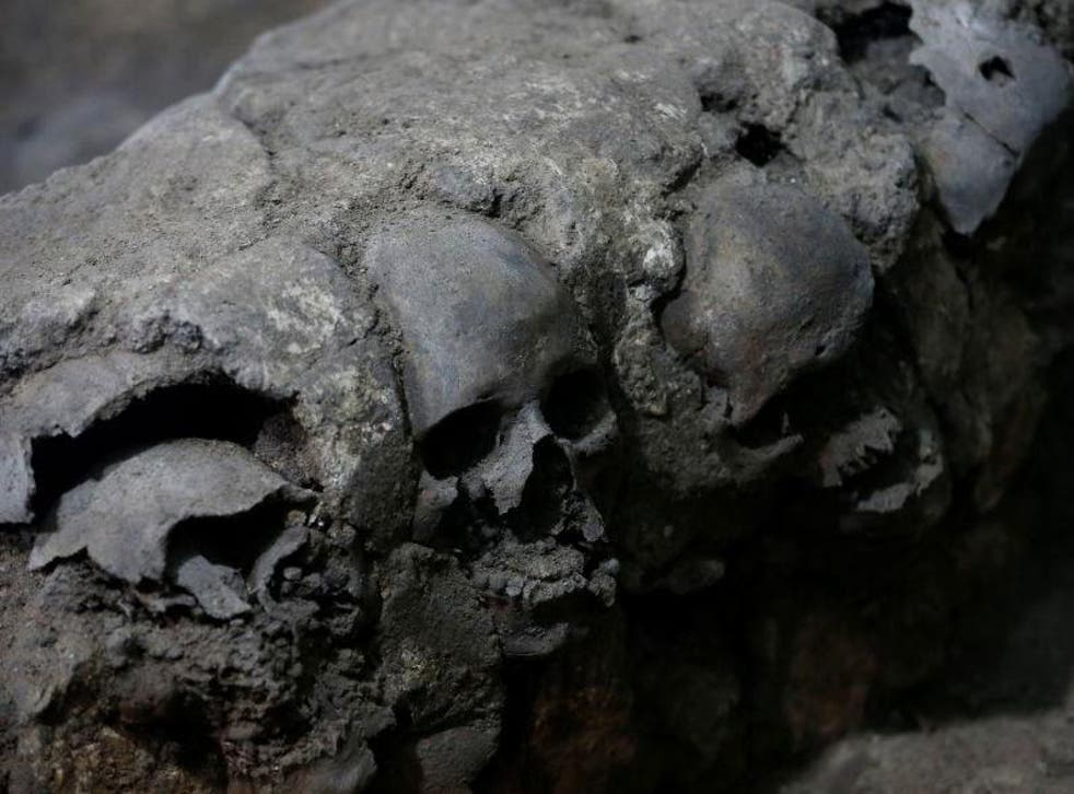 Skulls found at the site included women and children, perplexing archaeologists