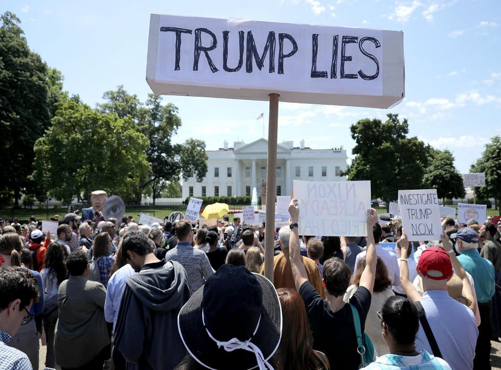 People protest outside the White House