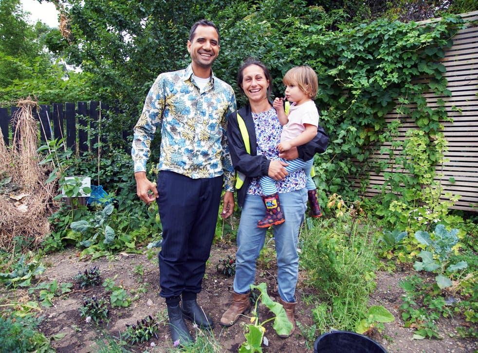 Agamemnon Otero, co-founder of Repowering London, with Patti Zogolovitch and her daughter Floretta in the Energy Garden at Brondesbury Park Overground station in London