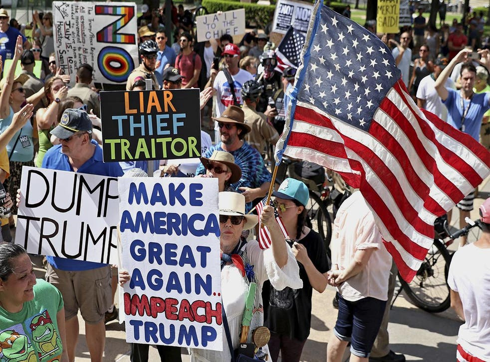 Anti-Trump supporters rally in Austin, Texas