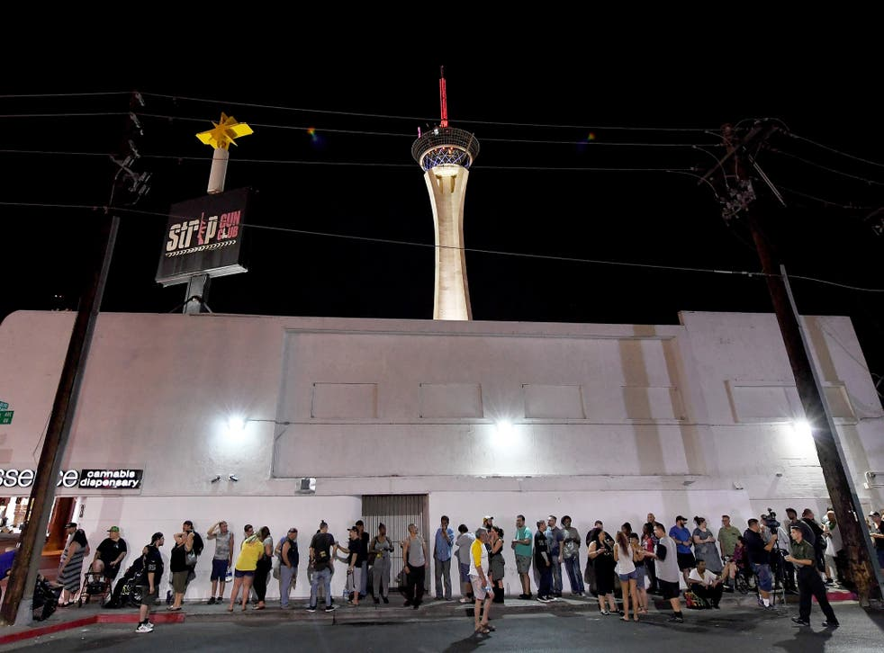 Customers line up outside Essence Vegas Cannabis Dispensary as they wait for the midnight start of recreational marijuana sales to begin