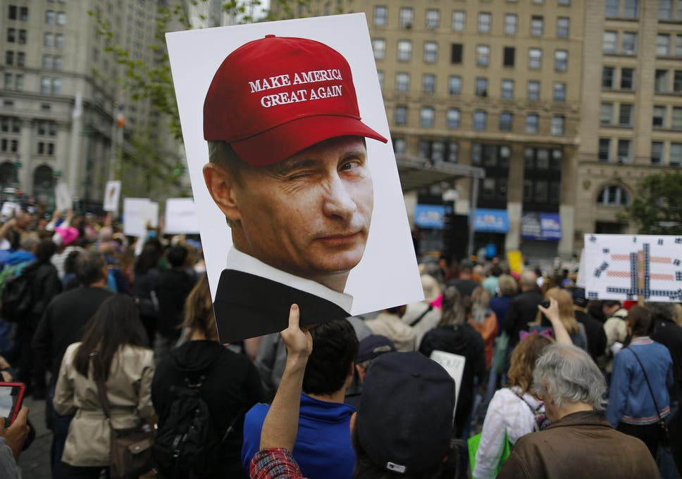 33a6cc0d664 A demonstrator holds up a sign of Vladimir Putin during an anti-Trump  March