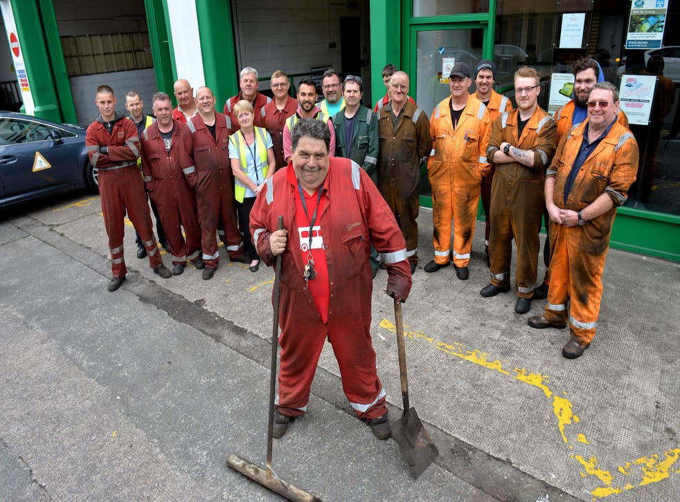 Mr Condon pictured with his colleagues