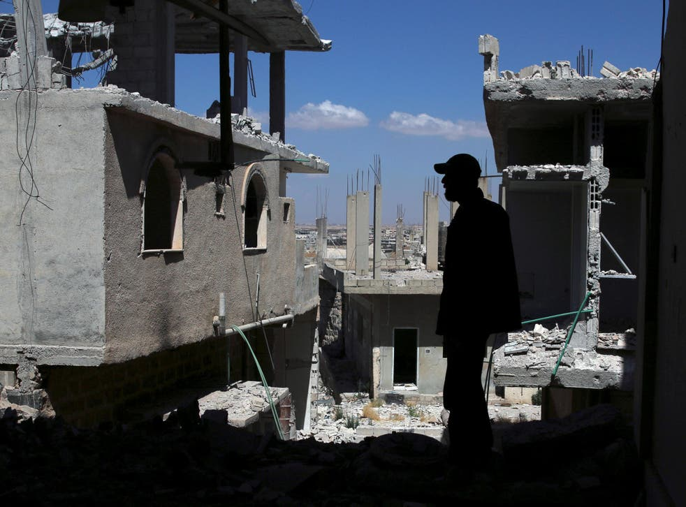 What were once residential buildings in the rebel-held part of the southern Syrian city of Daraa last month
