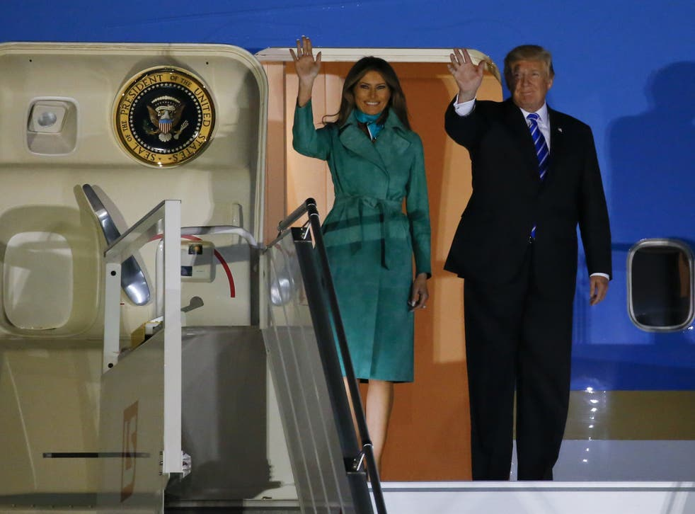 US President Donald Trump and First Lady Melania Trump arrive at Warsaw military airport in Poland