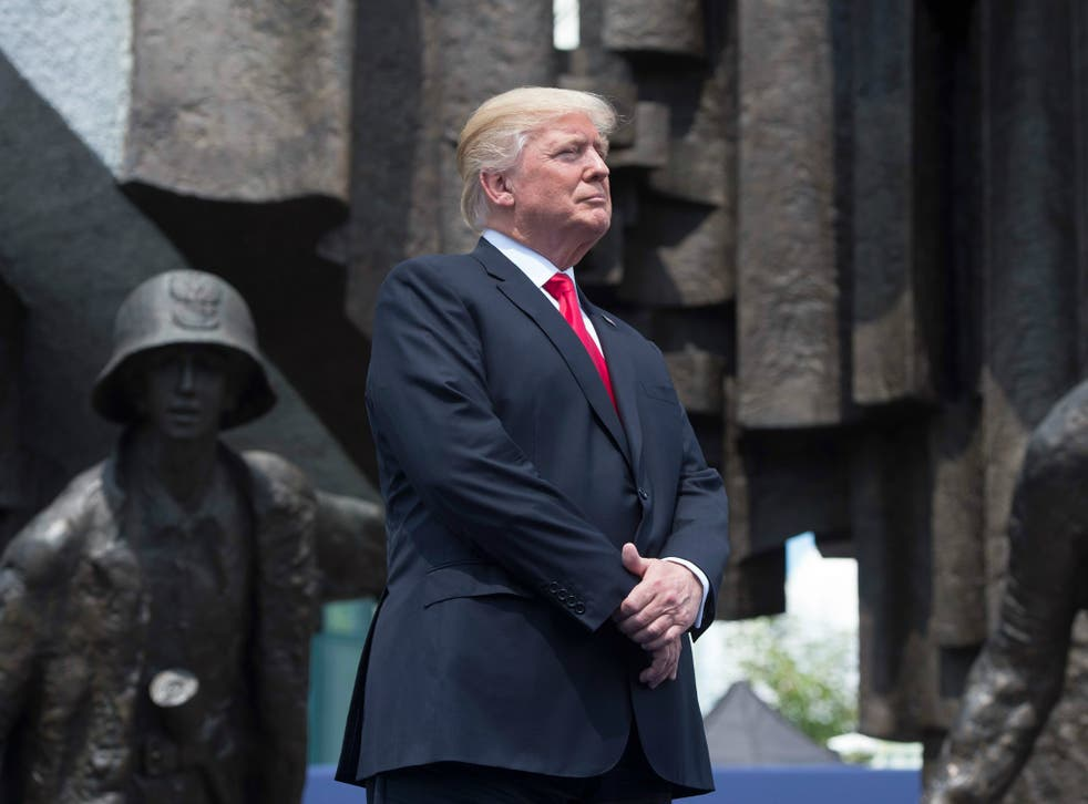 President Donald Trump stands in front of the Warsaw Uprising monument in Krasinski Square ahead of his address