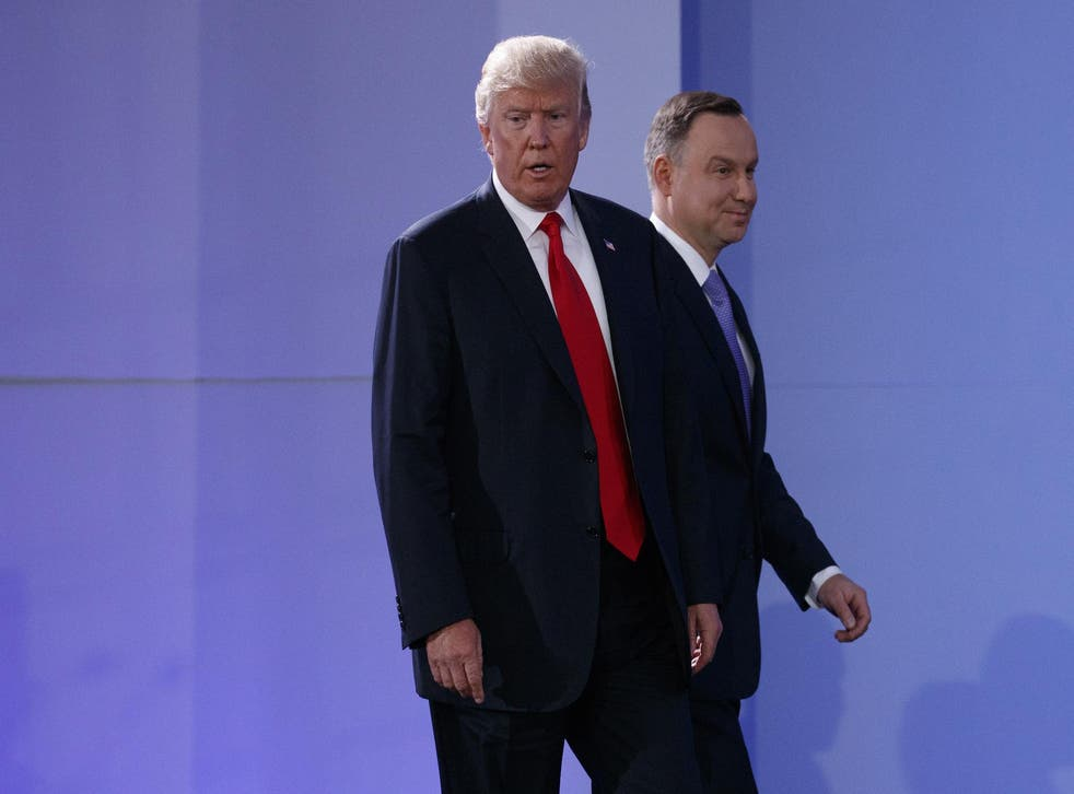 President Donald Trump and Polish President Andrzej Duda arrive for a news conference in Warsaw