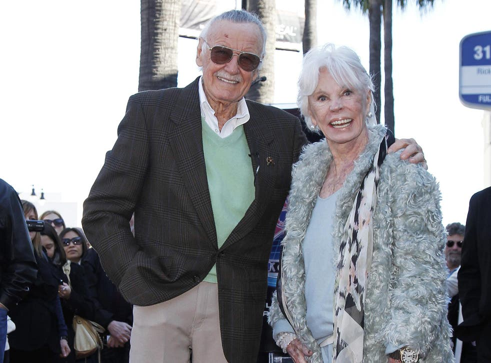 Comic book creator Stan Lee and his wife Joan pose on his star on the Hollywood Walk of Fame