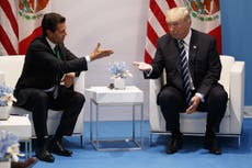 Trump says Mexico will pay for border wall after meeting with Nieto