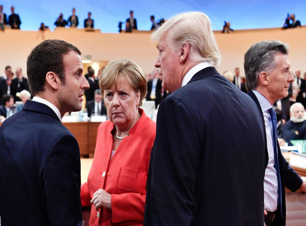 Mr Macron jumped through world leaders to stand next to Mr Trump