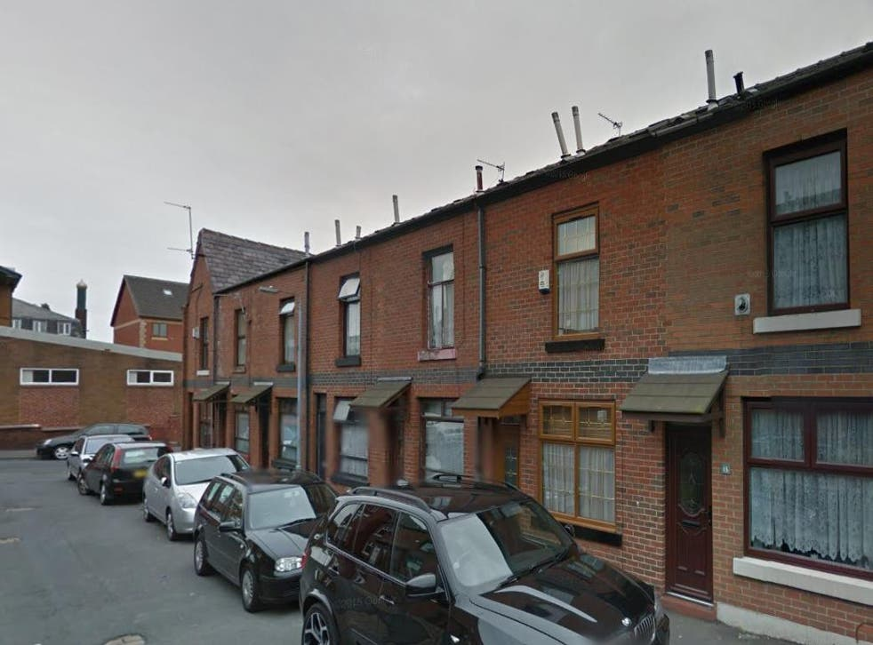 Witnesses said a man escaped by jumping out of a window