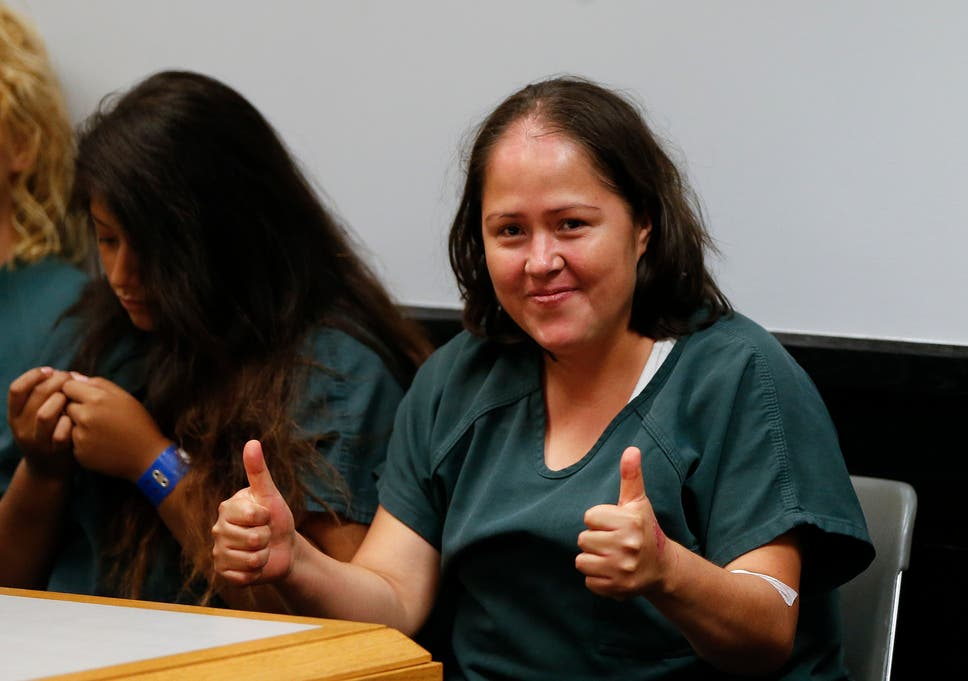 0bef61a0b4f38 Isabel Martinez gestures towards news cameras during her first court  appearance Lawrenceville