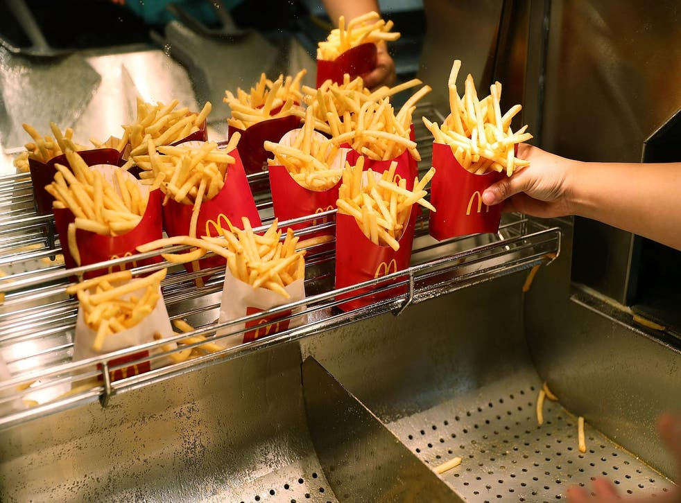 McDonald's crew member Samantha Medina prepares french fries as the McDonald's restaurant stock price reached record territory on April 25, 2017 in Miami, Florida