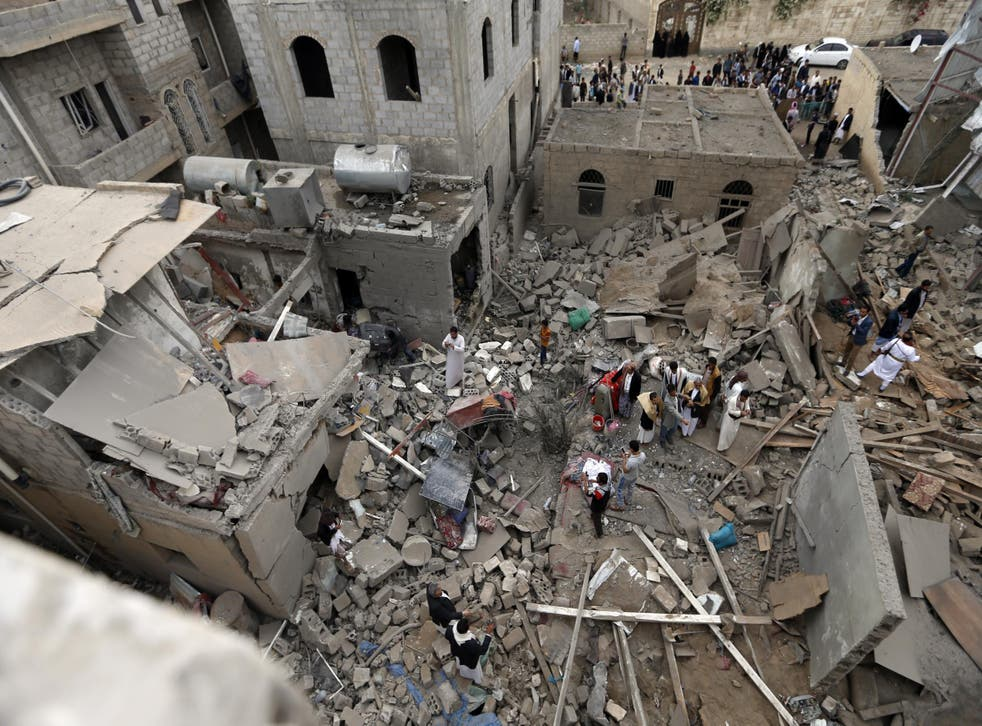 Yemenis stand on the rubble of houses destroyed in a suspected Saudi-led coalition air strike in Sanaa on June 9, 2017