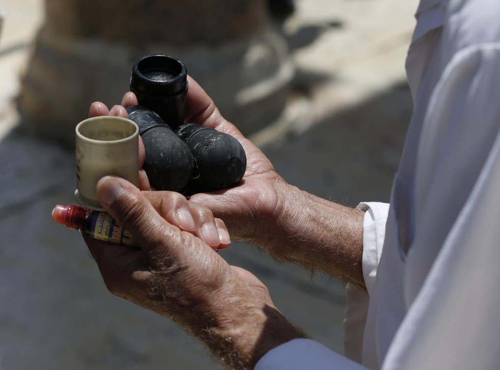 Man holds new black sponge-tipped bullets used by Israeli police