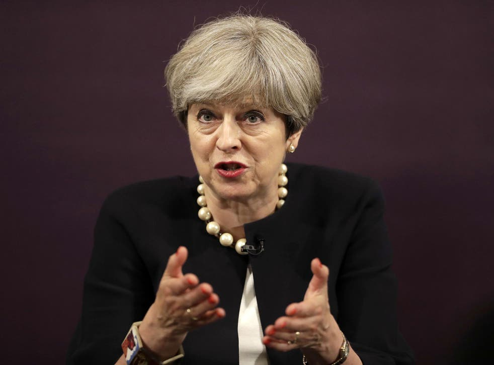 Theresa May urged Conservative MPs to end their 'backbiting' or pay the price