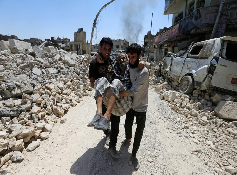 Civilians escape Mosul's old city during the battle against Isis last month
