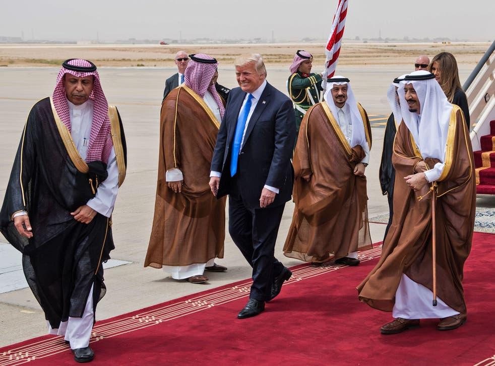 Donald Trump is welcomed by Saudi King Salman bin Abdulaziz Al Saud during a visit earlier this year