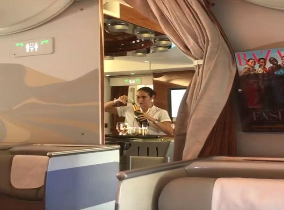 Footage has emerged of an Emirates stewardess pouring Champagne back into the bottle