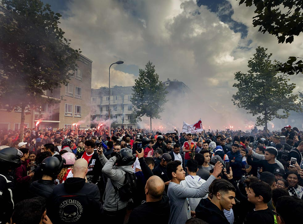 Fans gather outside of the home of Dutch midfielder Abdelhak Nouri on July 14, 2017 in Amsterdam.  Ajax Amsterdam's football player Abdelhak Nouri was diagnosed with 'serious and permanent brain damage' after collapsing on July 8 during a practice match against Werder Bremen. / AFP PHOTO / ANP / Robin van Lonkhuijsen / Netherlands OUTROBIN VAN LONKHUIJSEN/AFP/Getty Images