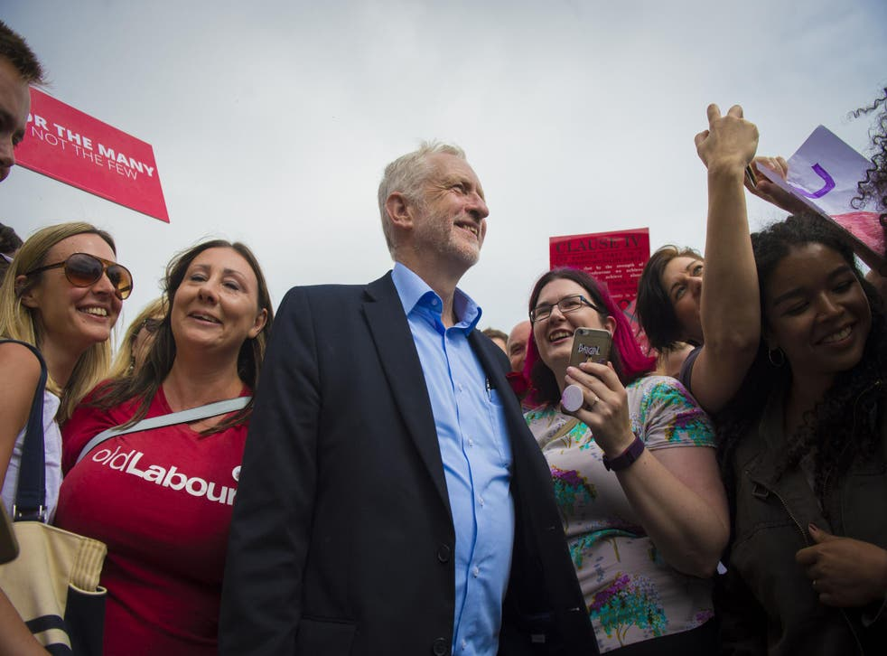 Jeremy Corbyn is greeted by supporters as he visits the West Cliff area of Bournemouth
