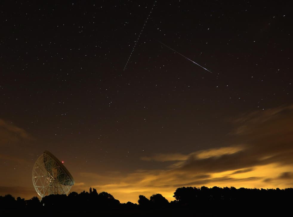 A Perseid meteor streaks across the sky over the Lovell Radio Telescope at Jodrell Bank on August 13, 2013 in Holmes Chapel, United Kingdom